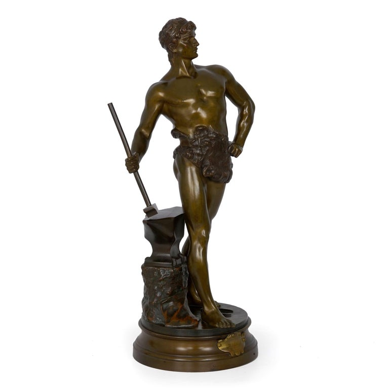 """With an exquisite polychromed patina, there is a complexity to this figure of """"Le Trevail"""" that is most striking. Utilizing a range of chemicals to bring varying hues of bronze, brown, gold and black to the surface, these were then carefully"""