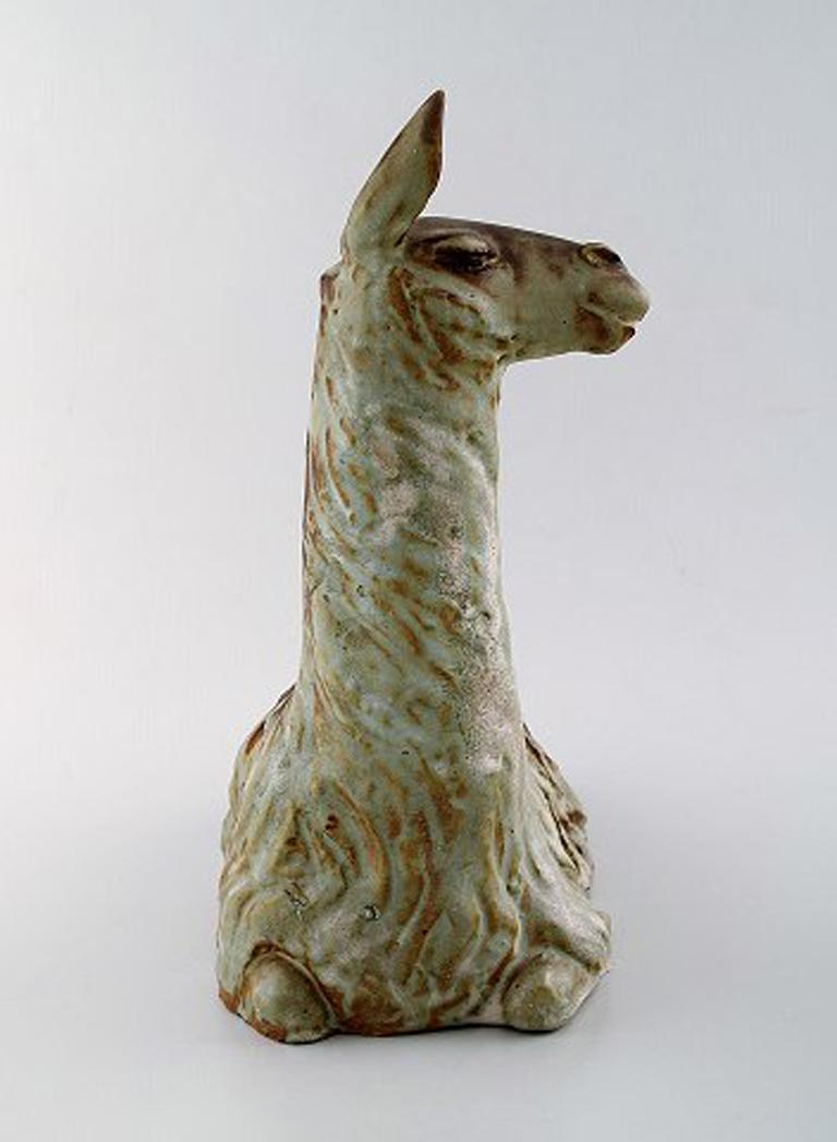 Lea von Mickwitz (1884-1978) for Arabia. Large sculpture in glazed stoneware. Lama. Beautiful glaze in brown and green shades, 1940s. Measures: 28 x 25 cm. In very good condition. Stamped.