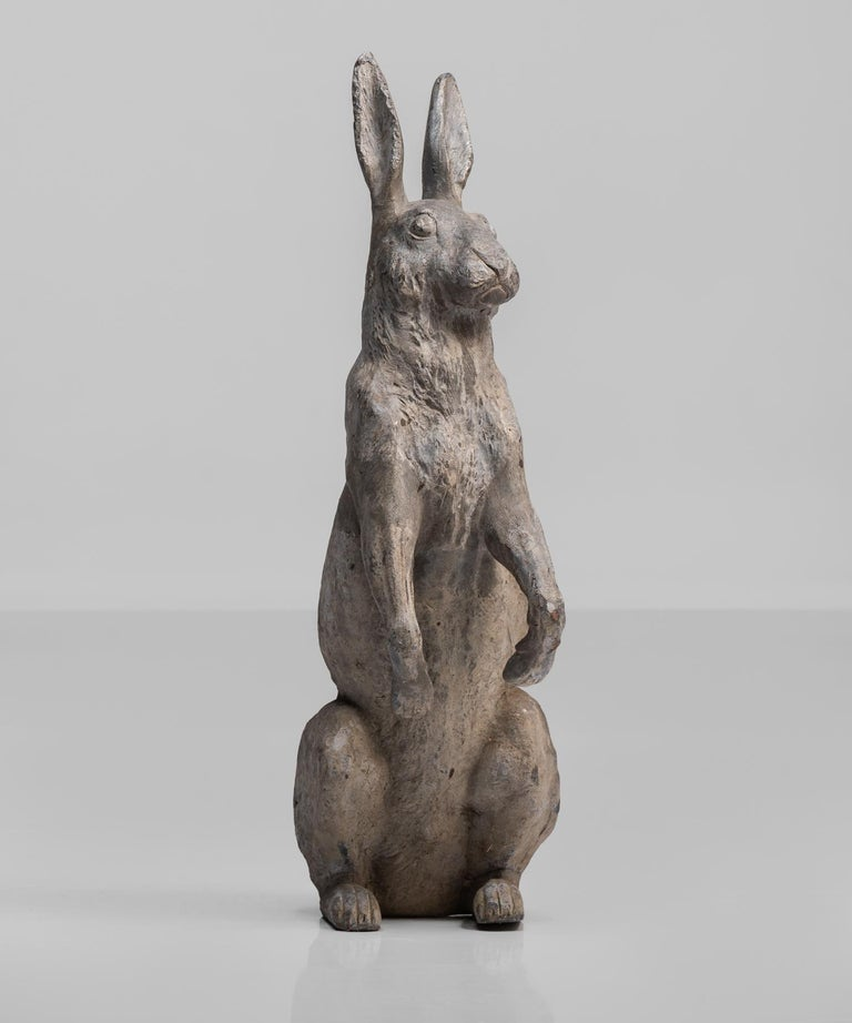 Lead garden rabbit, England, circa 1920.