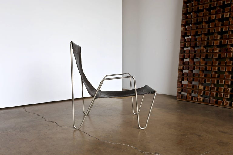 Brown leather 'Bachelor' chair by Verner Panton for Fritz Hansen.
