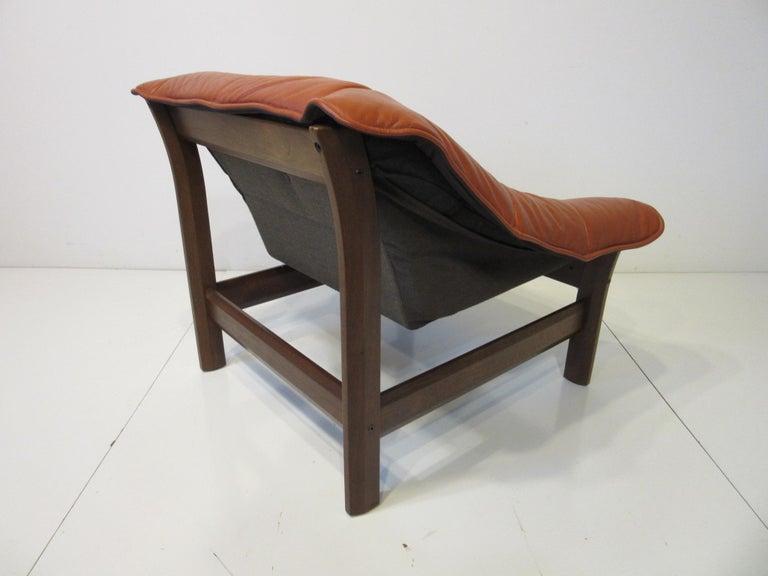 Mid-Century Modern Leather and Rosewood Lounge Chair by Percival Lafer, Brazil For Sale