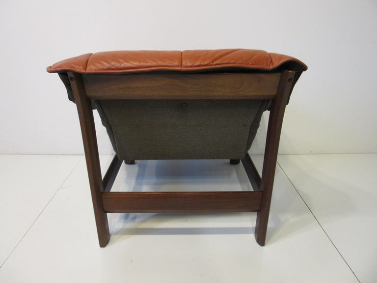 Brazilian Leather and Rosewood Lounge Chair by Percival Lafer, Brazil For Sale