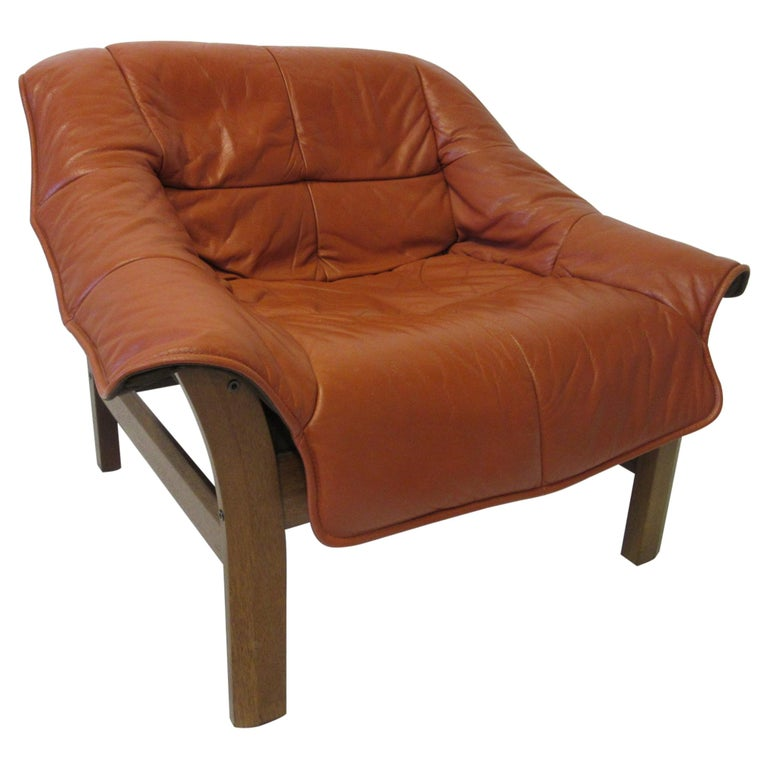 Leather and Rosewood Lounge Chair by Percival Lafer, Brazil For Sale
