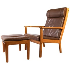 Leather and Solid Ash Mid Century Armchair and Foot Stool, Hans Wegner, Denmark,