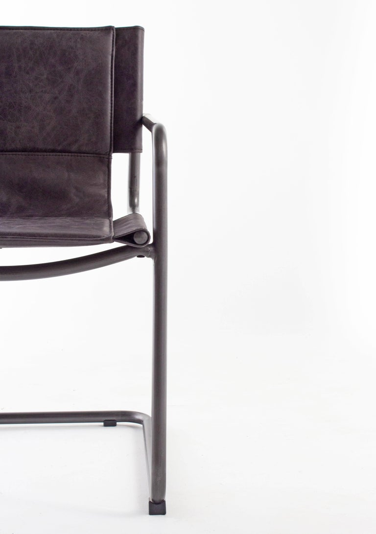 Modern steel and leather sling chair.