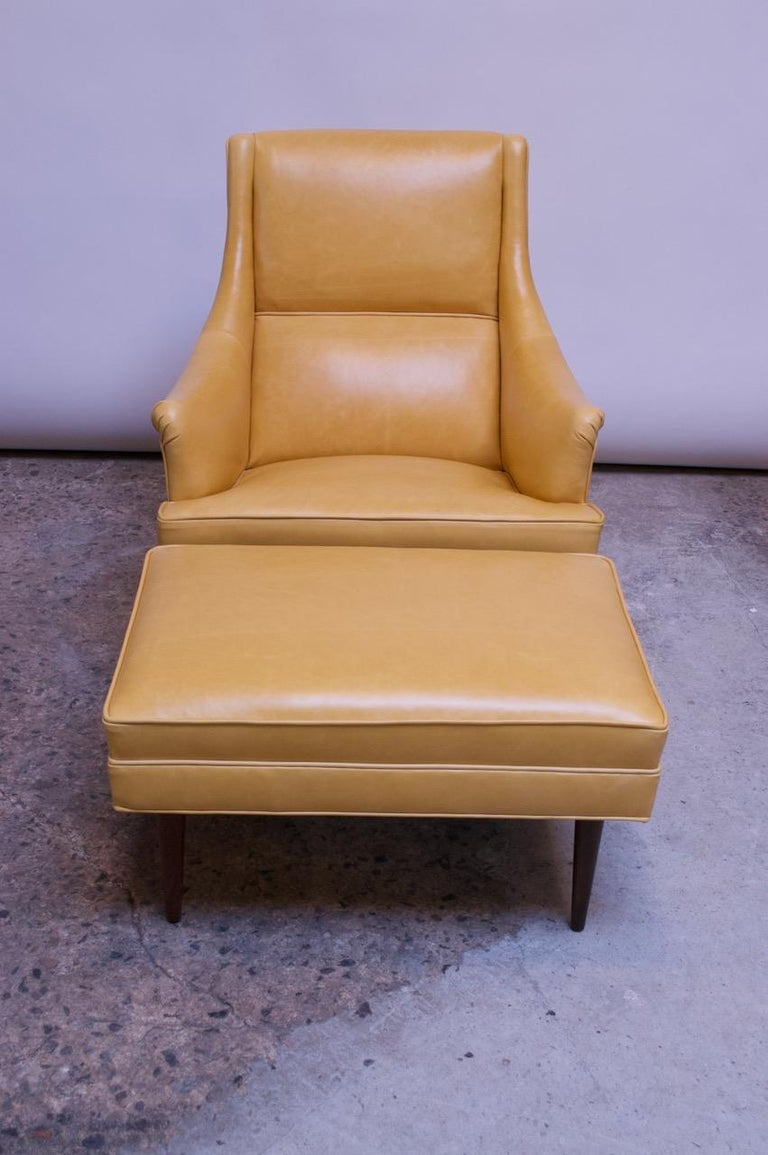 Beautifully designed and well constructed Milo Baughman for James Inc. lounge chair and ottoman supported by turned, walnut legs. Clean lines with generously curved, sweeping arm rests for additional comfort. Newly reupholstered in leather with new