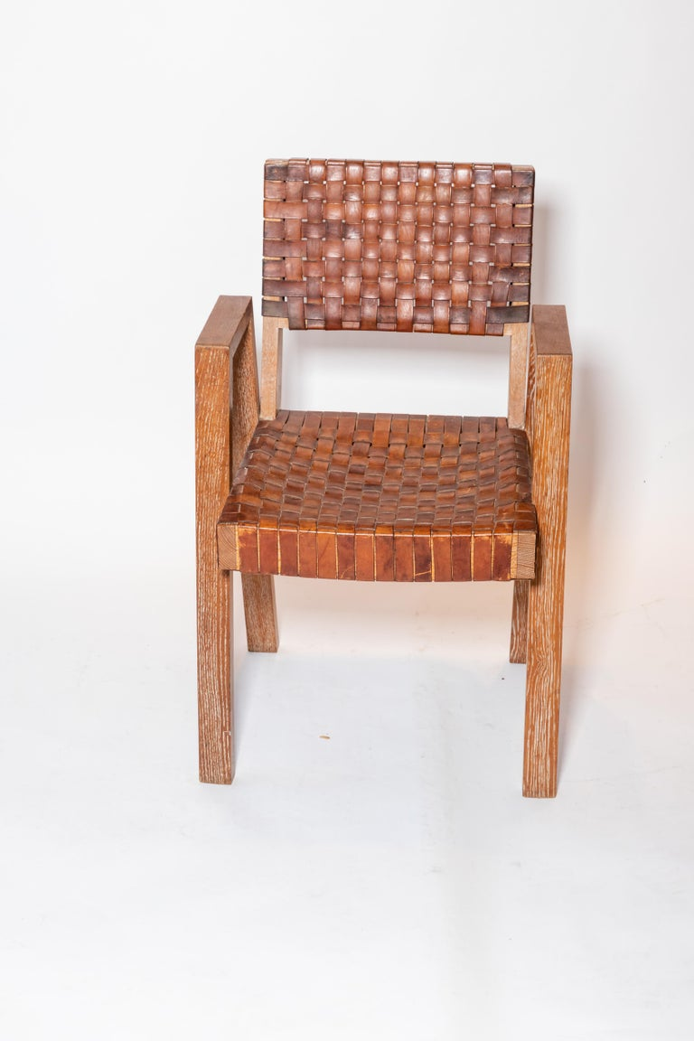 Leather and wood chairs, France, circa 1940-1950. 4 are available.