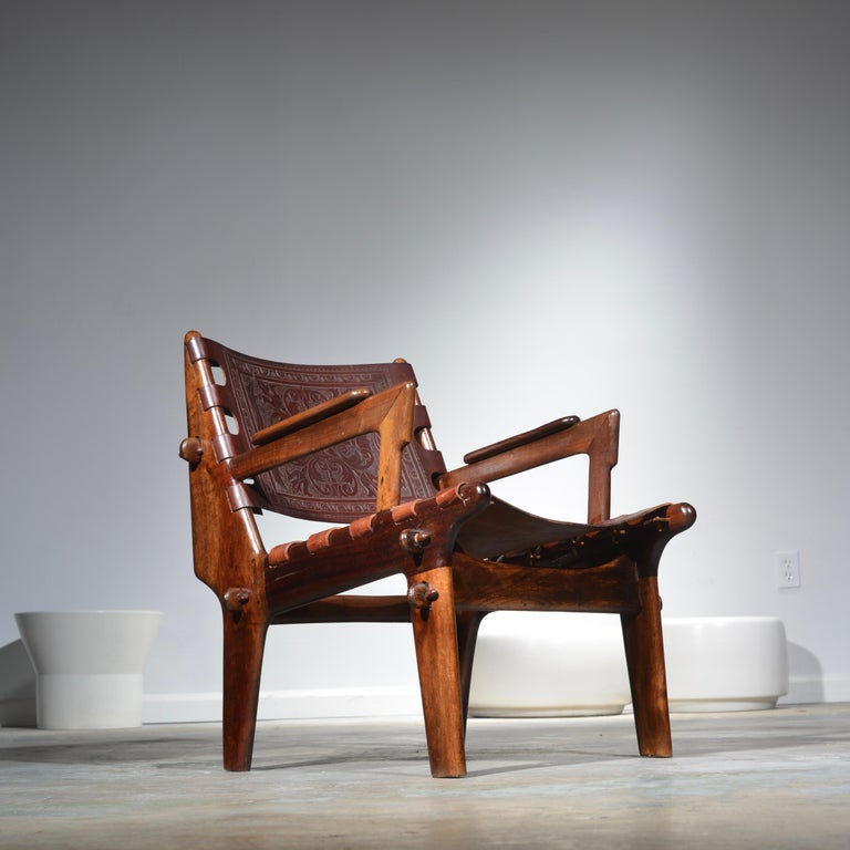 Rosewood and leather armchair by Angel Pazmino for Muebles De Estilo circa 1960 Ecuador. This chair is in original condition.