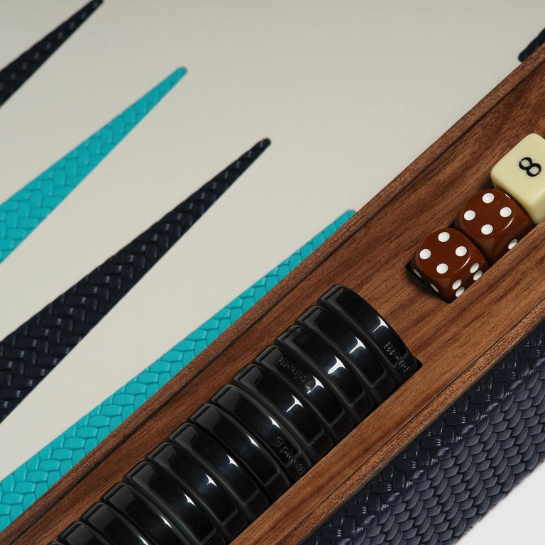 Dynamic and unpredictable, this backgammon boardgame set is a lavish accent piece for both modern and traditional interiors. The set box is crafted exclusively of Canaletto walnut, with the interior boasting a colorful design with black and