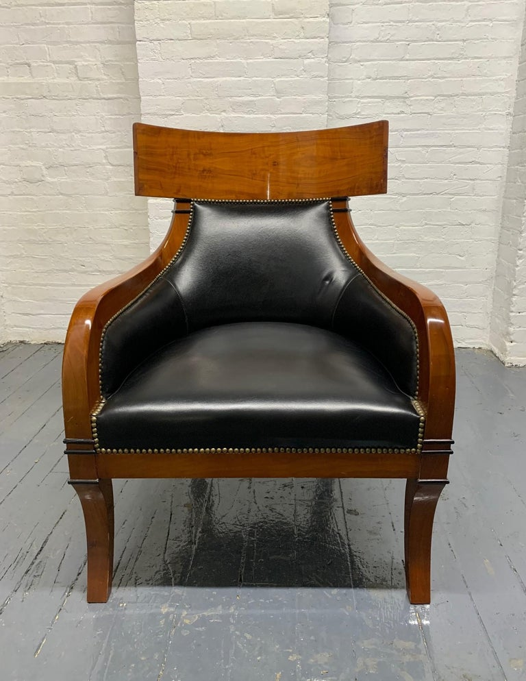 Leather, Biedermeier style lounge chair.