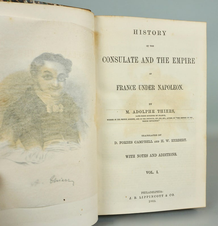 A 5 volume history of the French Consulate and Empire under Napoleon written by famous historian and later French President Adolphe Thiers, in 3/4 brown leather bound volumes with raised gilt tooled spines, marbleized endpapers and boards and