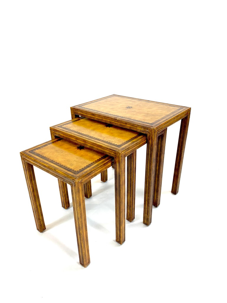 Substantial yet diminutive set of 3 nesting tables by Maitland Smith. Meticulous leatherwork and pyrography evident in these beautiful tables.