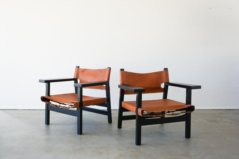 Leather Campaign chairs in style of Børge Mogensen stained in ebony. Beautiful patina to leather with contrast stitching and buckle hardware.