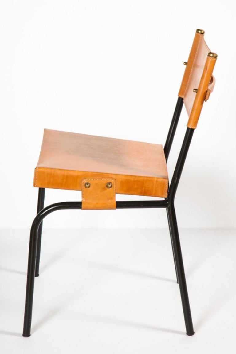 Original black metal structure with brass hardware attaching the (replaced) leather seat and back.  Measures: Seat height 18.75