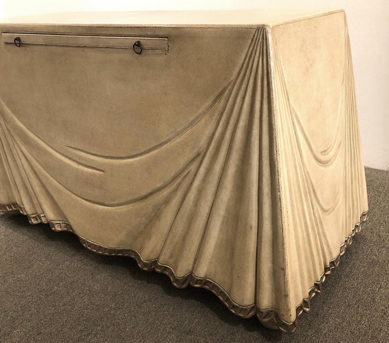 Console table or serving table completely covered in leather. Features a pullout shelf. for writing or serving. Excellent quality. Designed and manufactured by Marge Carson.