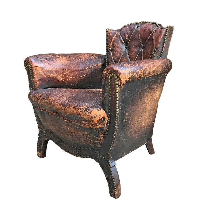 An important club chair design by Swedish modernist, Otto Schulz with original leather upholstery, original brass nailhead trim, and a wonderful patina. Otto Schulz (1882-1970) was a German born architect, designer and publisher who operated the
