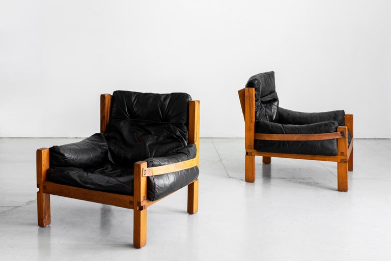 Fantastic pair of leather club chairs designed by French designer Pierre Chapo, model
