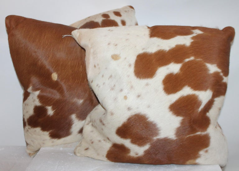 Double sided leather cow hide pillows with zippers for removal of inserts. The condition are very good and they are double sided.