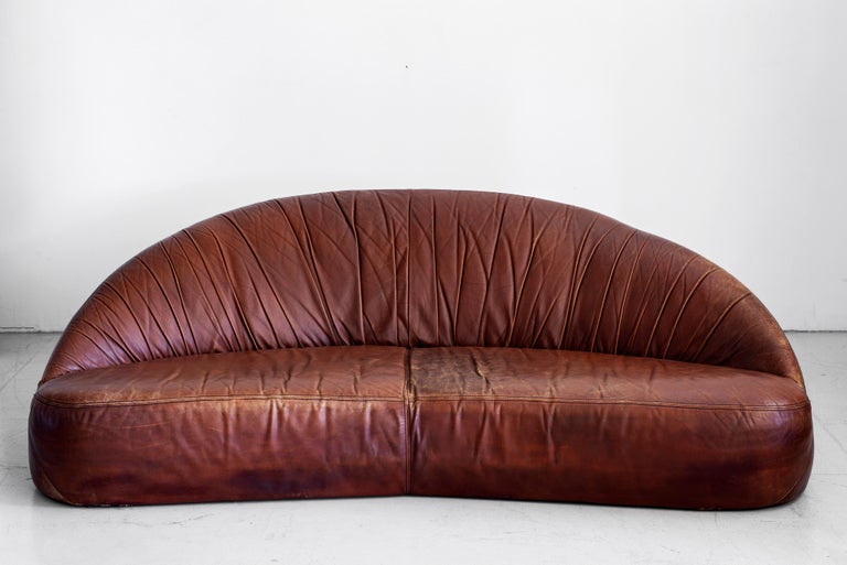 Great demilune sofa in rich brown original leather, France, circa 1970s. Nice patina and age to leather. Matching smaller sofa also available.