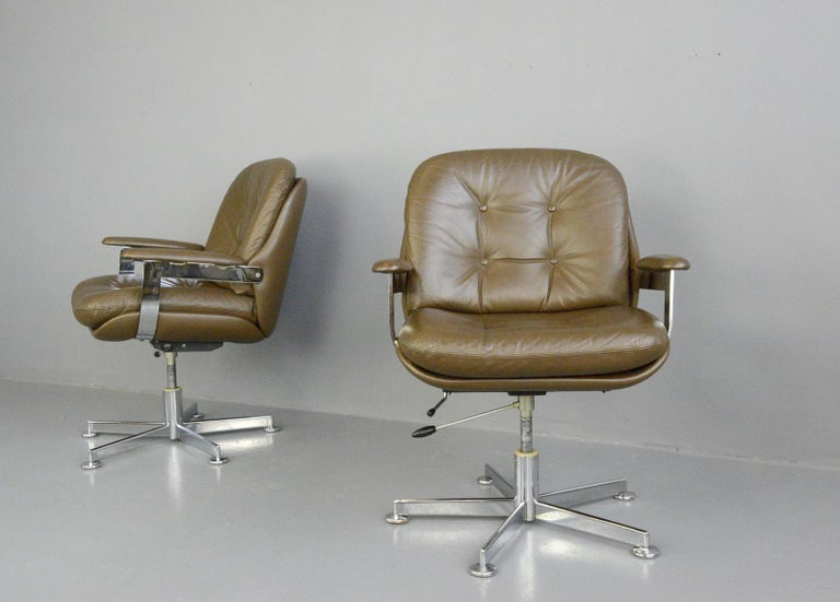 Leather executive chairs by Ring Mobelfabrikk, circa 1970s.  - Price is per chair - Quality chocolate brown leather  - Button back - Height adjustable and reclining  - Polished chrome arms and base - Made by Ring Mobelfabrikk - Norwegian,