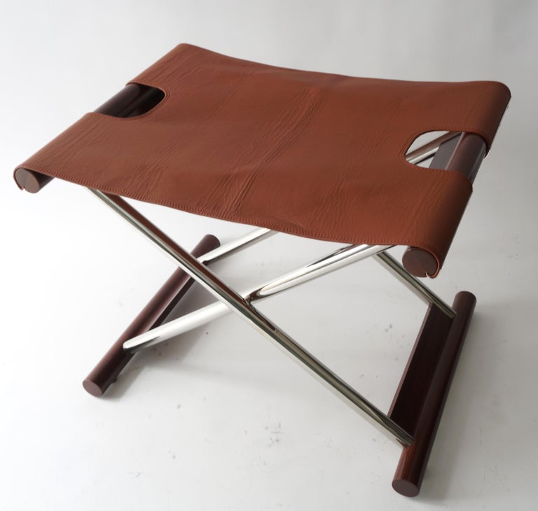 Vintage folding X-Sling stool in leather polished stainless steel and mahoganyfrom a Palm Beach estate.  size when opened is 23 wide, 17.5 deep, and 19
