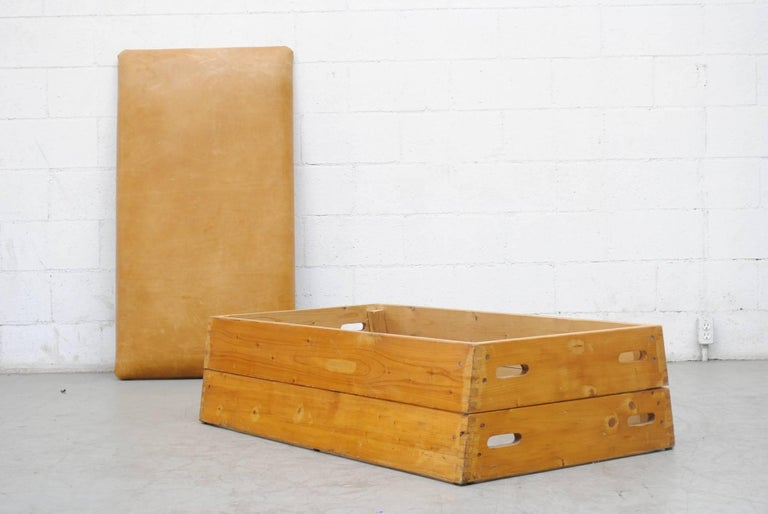 Original Dutch Gymnastics Vault Trans formed into a low multi purpose ottoman-bench-coffee table in teak and oak with leather top. Two-tiered stack-able. Original condition with visible scratching and wear, nice patina.