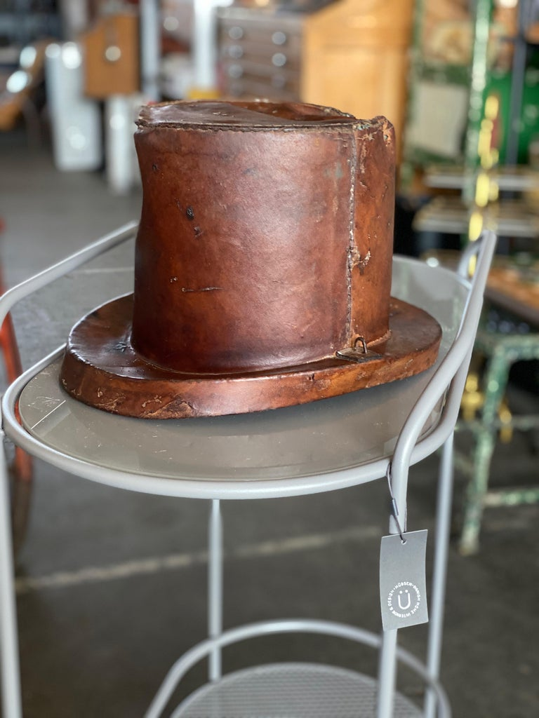 Leather hat box for cylinders, late 18th century. Rare old hat box made of leather and cardboard for cylinders. This old hat box in the shape of a cylinder is an original from the time, circa 1800. The box is hand sewn and shows strong signs of use.