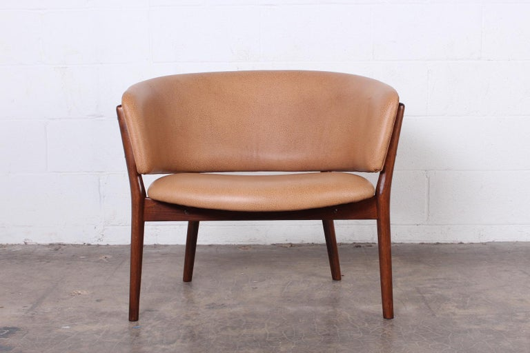 Nanna Ditzel lounge chair in teak and leather.