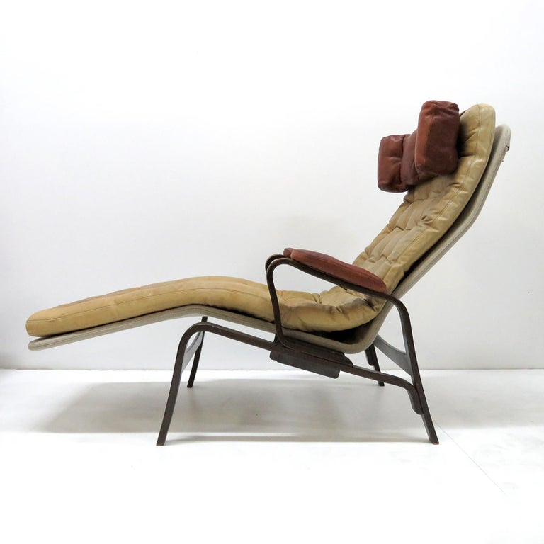 Wonderful reclining lounge chair/chaise by Sam Larsson for DUX, 1970, in camel colored leather on a canvas covered metal frame. Headrest and arm cushions in cognac colored leather on a dark-stained bentwood frame, marked with DUX print on the back