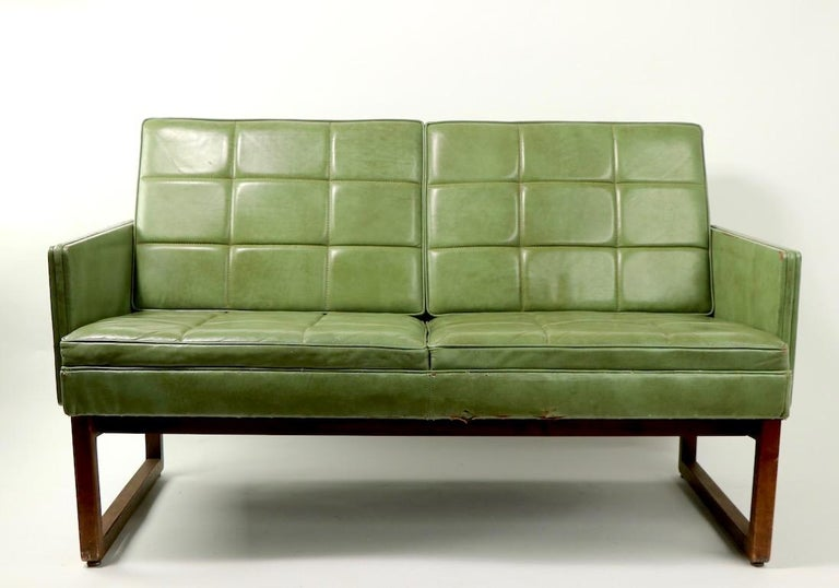 Loveseat scale sofa in nice distressed leather, on wood legs.  Smart Classic design and style, works for modern and or traditional interior spaces  Total H 30 x arm H 22x seat H. 16 inches. - Signed Gunlocke.