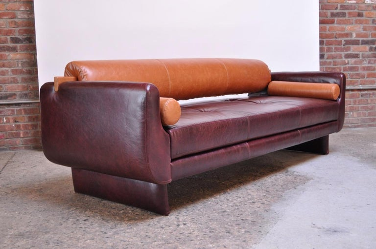 Remarkable sofa designed by Vladimir Kagan for American Leather Studios composed of two removable bolster accent pillows and back bolster in leather. The removal of the back bolster converts the sofa to a daybed. Completely redone with brand new