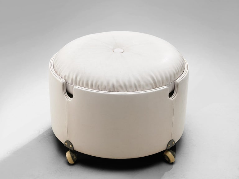 Luigi Massoni for Poltrona Frau, pouf on wheels, leather, plywood, Italy, 1968.  This pouf designed by Luigi Massoni for Poltrona Frau and is part of the Dilly Dally series. The pouf is made out of curved and padded plywood covered with leather and