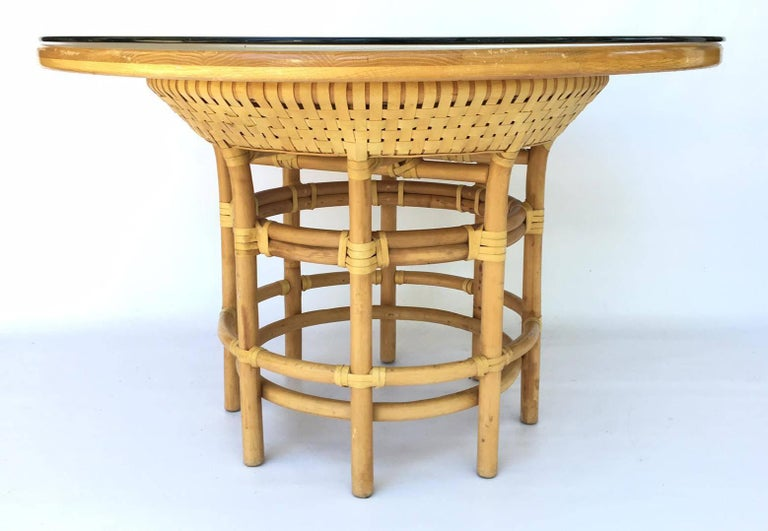35bbd33fb8ece Leather-wrapped rattan base dining table with round solid wood top.  Removable 48