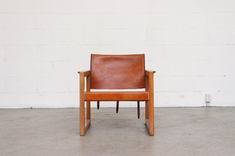 Natural leather and wood framed Safari style chair with leather strapping and studded detail. In very original condition with visible wear and nice patina to the leather.