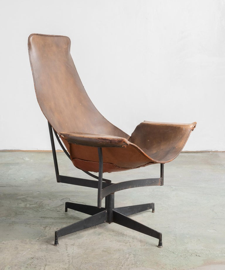 Leather Sling chair by William Katavolos, circa 1950.  A well-patinated leather form rests atop a metal structure. Designed for Leathercraft.  This item ships from Providence, Rhode Island.