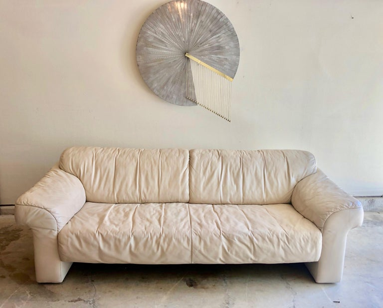 Leather sofa by WK Möbel in a light cream / ivory color. This sofa is extremely comfy and great for long term lounging!