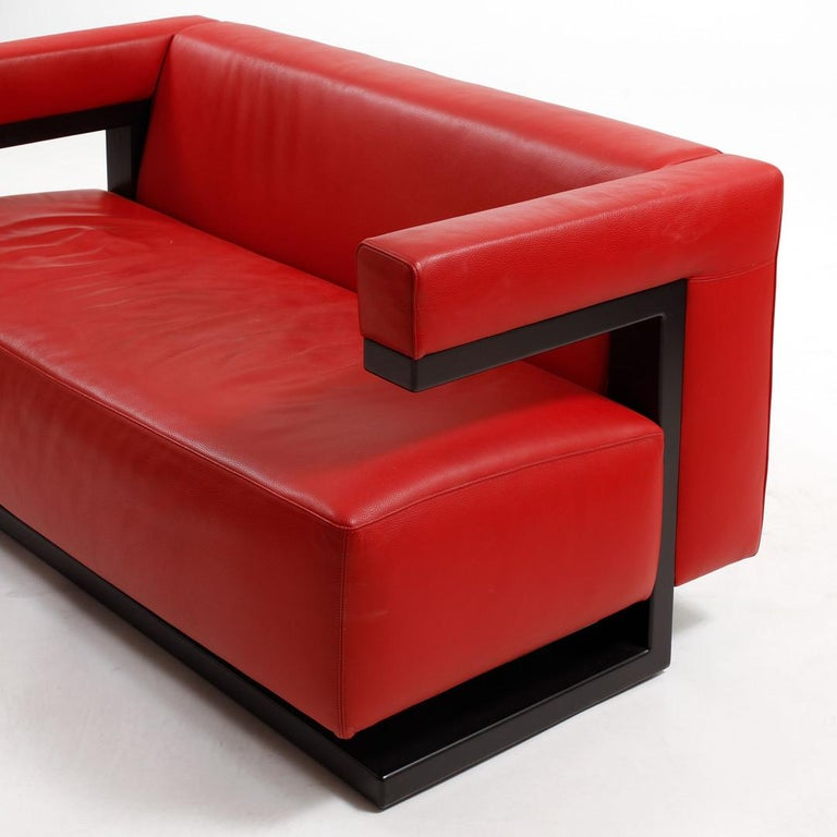 Hardwood frame black painted and upholstered with red leather. Designed by the founder of the Bauhaus Walter Gropius in 1920. The F51-2 2-seat sofa as a complementary piece of furniture to his strictly geometric and cubic director's room at the