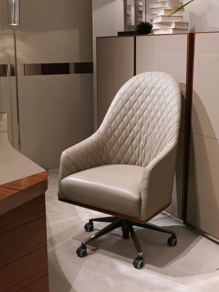 Leather Swivel Desk Chair by Umberto Asnago for Medea Mobiledia, Italy  Offered for sale is a leather swivel desk chair designed by Umberto Asnago for Medea Mobilidea, Italy. The leather is beautifully stitched to create a quilted diamond pattern to