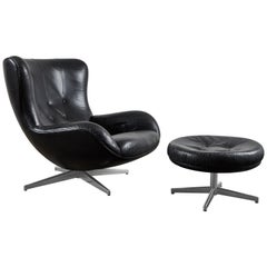 Leather Swivel Lounge Chair and Ottoman by Illum Wikkelsø