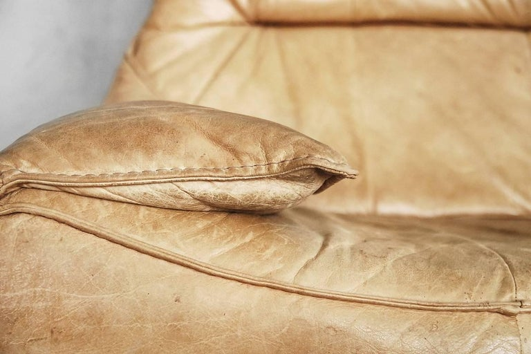 This two-seat sofa, model the Rock, was originally named Florence and was one of the first designs by Gerard van den Berg for Montis. It was produced during the 1970s and is made of cognac brown patinated leather. Due to specific armrests, which are