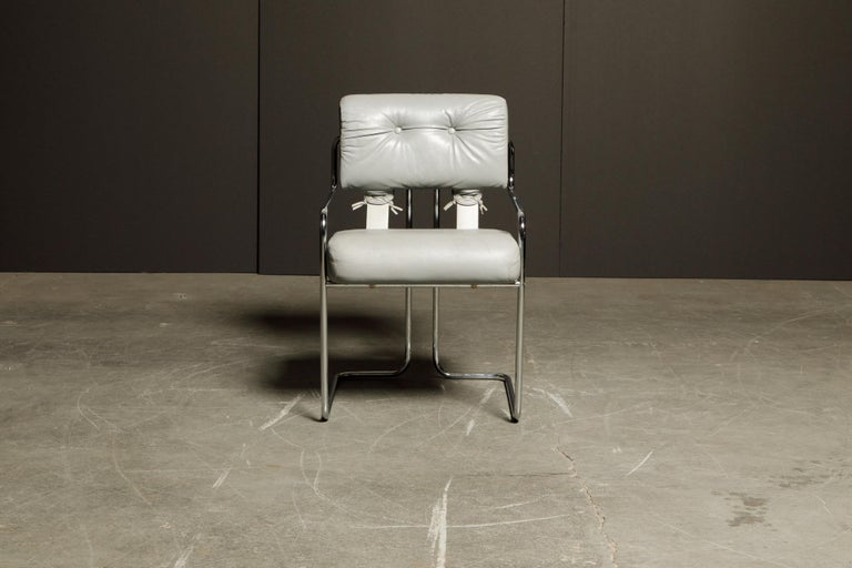 A beautiful Tucroma armchair by Guido Faleschini for i4 Mariani in beautiful light grey leather with polished chrome frame. The seat and back retains its original supple light gray leather upholstery and attached to graceful steel tubular frames, as