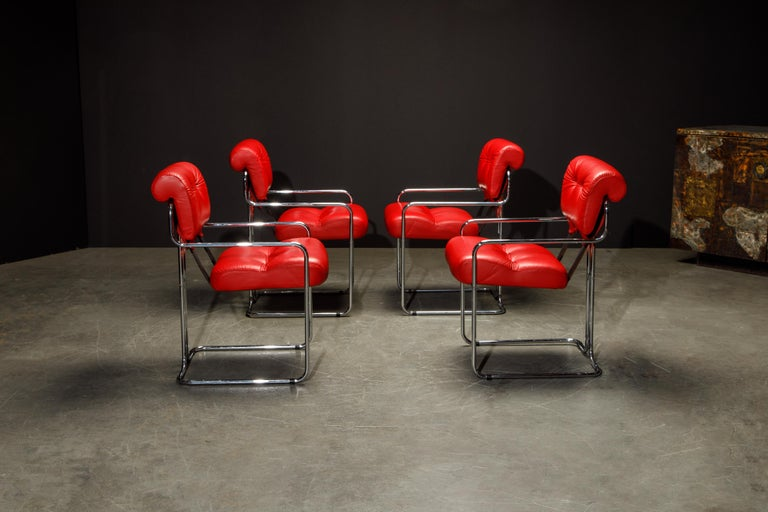 A beautiful set of four 'Tucroma' armchairs by Guido Faleschini for i4 Mariani in beautiful red leather with polished chrome frames. The seats and backs retains its original supple red leather upholstery and attached to graceful steel tubular