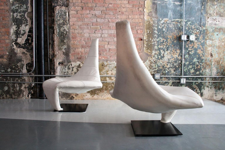Beautiful sculptural white leather lounge chairs named Turner, and nicknamed