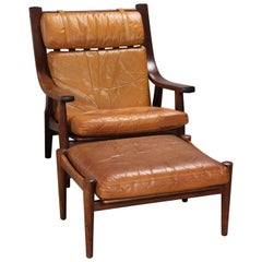 Leather Upholstered Armchair and Ottoman by Hans Wegner