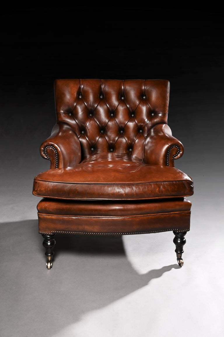 A quality leather upholstered buttoned back armchair. This well-proportioned armchair has been upholstered in a hand-dyed leather Hyde. The unique design is a one-off and very comfortable and will work in a traditional and contemporary