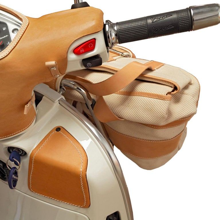 A limited edition Vespa perfect for true Vespa afficionados. Inspired by the timeless design and spirit of the iconic scooter, the piece is covered with vegetable-tanned hand -crafted, hand-stitched leather covers that are detachable. Sun-dried and
