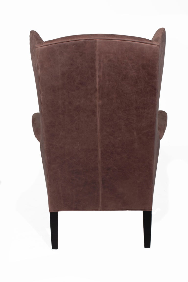 Can be sold as a set, listing is for a single chair.  Fabric: Leather Burnham Coco Fill: Haven Finish: Ebony  Lee Industries Model L1413-01 Made in High Point, NC  Floor sample, excellent condition.