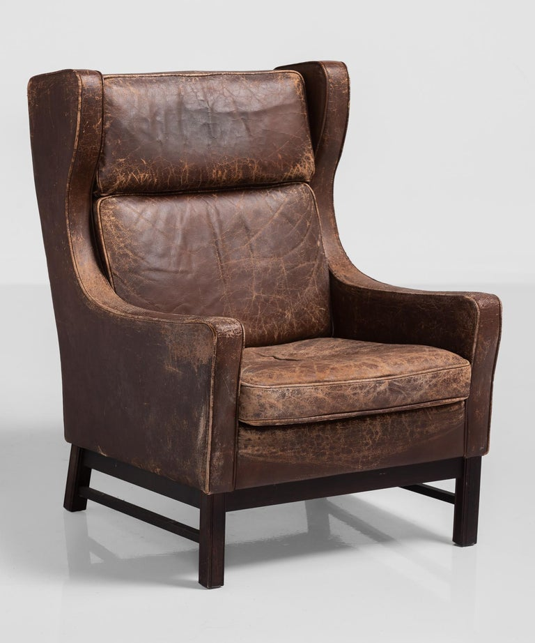 Leather wingback armchair, Denmark, circa 1960.