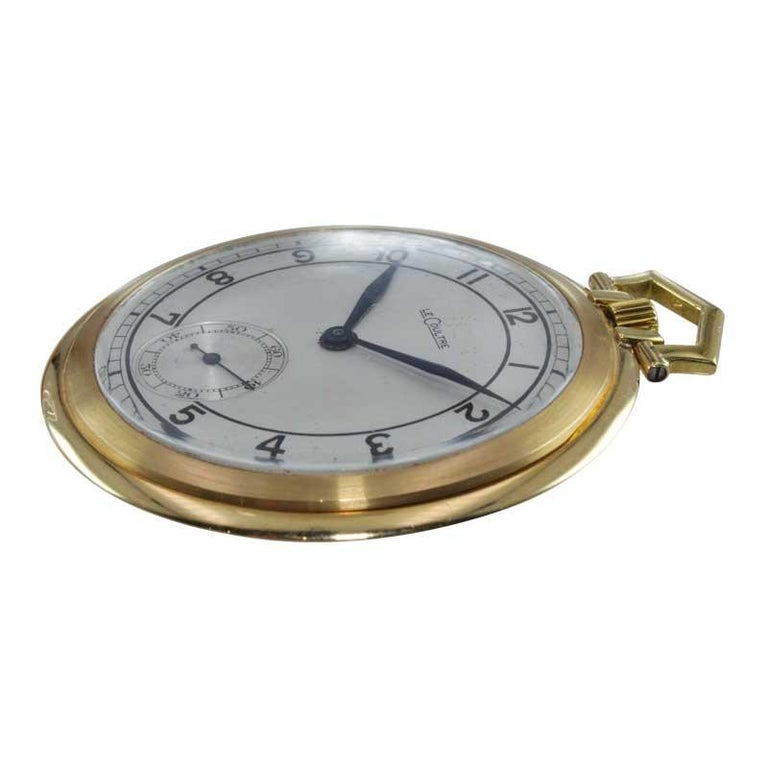 FACTORY / HOUSE: LeCoultre STYLE / REFERENCE: Open Face Pocket Watch METAL / MATERIAL: 18K Yellow Gold CIRCA / YEAR: Late 1940's DIMENSIONS / SIZE: 48mm MOVEMENT / CALIBER: Manual Winding / 15 Jewels  DIAL / HANDS: Original Silver Dial / Blued Steel