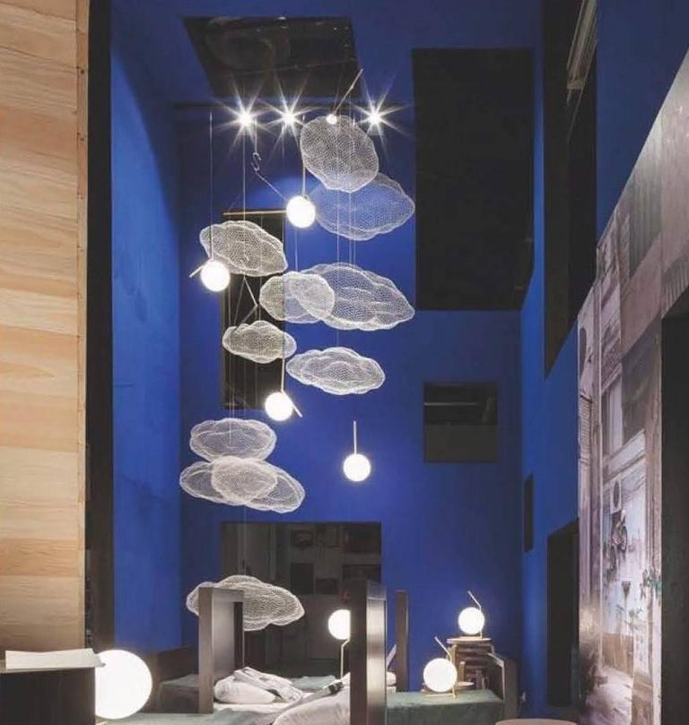 Unique chandelier where hundreds of small LED lights are combined with a handmade wire mesh sculpture shaped like a cloud. Six LED lights are mounted on the canopy and can be wired to a separate circuit. Finishes: Gold or white.